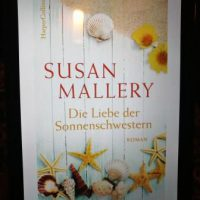 Buchcover auf Kindle Susan Mallery Die Liebe der Sonnenschwestern Seesterne und Muscheln auf dem Cover