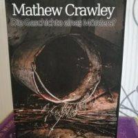 """Buchcover von """"Mathew Crawley - Die Geschichte eines Mörders?"""" von Dirk Jäger. Auf dem cover sieht man einen Eimer, der im Stroh liegt."""